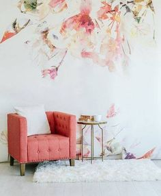 wallpaper design pink chair in bedroom.  Delicate watercolor flowers make for a stunning wallpaper. This statement is one you won't regret making.