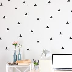 "$15 for 72  2"" white triangles, sheets 12""x24"" http://wallsneedlove.com/products/triangle-decal-mini-pack"