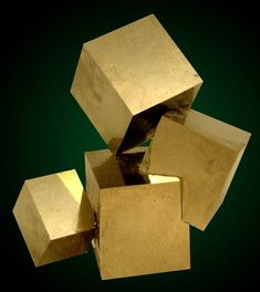 Pyrite crystal grouping, This is NOT man made, This is a natural formation of the mineral Pyrite.