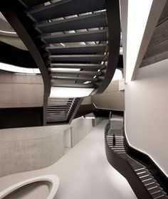 The MAXXI Museum immediately makes a big impression, thanks to this colossal black-painted steel staircase, which connects multilevel atriums. Designed by Zaha Hadid