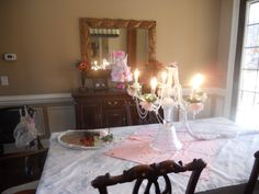 The second table in the formal dinning -room with the Chandelier for the baby's room. Had no place to hang it-sitting in a crystal bowel...