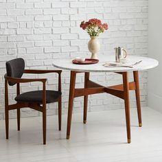Simple mid-century vibes and small size make this table a versatile little number.