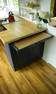 Great idea for an out-the-way butcher block.