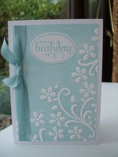 maker used brayer and Baja Breeze to ink directly onto one side of the Elegant Bouquet embossing folder then card placed in folder and run through the Big Shot - ink is only transferred onto the flat piece of card leaving the embossed part white