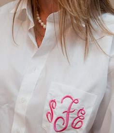 Monogrammed button downs... white for the bride and pink for the bridesmaids :)