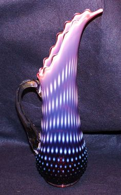 """Fenton Plum Opalescent Hobnail Pitcher Vase from cintiquities on Ruby Lane. Fenton Plum Opalescent was introduced in 1959 and stayed in production until 1962. The pitcher vase measures 15"""" tall. Just love the spout!"""