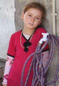 Yazidi Girl in the Khanki Refugee Camp, Iraq. Photographer: Charlie Ryan