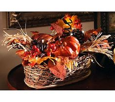 The unusual oval shaped basket and the glow of the lights take this harvest basket to the next level.