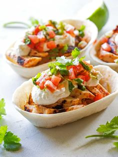 So much flavor in these Grilled Chicken Tacos with Feta Cream that it's hard to eat just one! Marinated chicken is grilled and topped with a spicy pico de gallo and topped with a whipped feta cream. A couple of months ago, as part of the Old El Paso Freshest Bloggers, we met in Nashville …