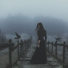 Oh, you see the ravens and the fog, but you forget the woman cloaked in black.