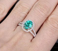 I want an Emerald and diamond ring and this oval cut with the diamond halo is gorgeous