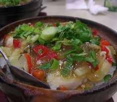 Cantonese fish soup.Delicious Chinese soup with vegetables,fish and rice.