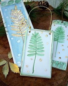 what about pressing pine bough into the clay to create the tree... could possibly even leave them in and they would just burn away in the kiln
