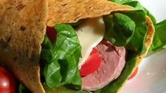 Roast beef, Neufchatel cheese, tomatoes, and greens are all wrapped up in multi-grain wraps for this light and tasty lunch.