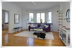 Bay window, oak floors and burgundy sofa. Almost like our home.