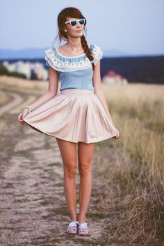 Nude skirt and sky-blue blouse