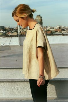 I made this top out of some beige linen scraps I had left-over from another project. I had a big baggy sweatshirt that I loved the cut/drape of so I copied that basic pattern for this top (minus the sleeves). I then painted the linen pieces with little gold 'X''s - painted densely at the neck...