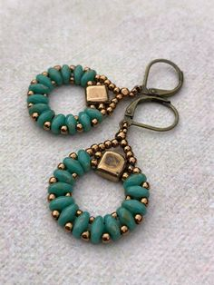 Excited to share this item from my shop: Turquoise and Bronze Beadwork Dangle Earrings Czech Super Duo Seed Bead Boho Earrings Gift Handmade Lightweight Earrings Bisuteria Haben Sie mehr Informationen auf unserer Site Beaded Earrings Patterns, Jewelry Patterns, Bead Earrings, Beaded Necklace, Beaded Bracelets, Earrings Online, Chandelier Earrings, Beaded Chandelier, Black Chandelier