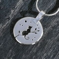Handmade sterling silver pendant 'Kitten on a Branch'. A very curious kitten gazes from the branch of her favourite tree. I cut out my design with a jewellers saw blade. The surface is brushed it to a…MoreMore #SilverJewelry