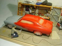Cool diorama showing a shop with a car getting painted! Captian Obvious