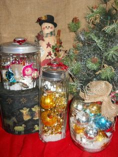 Vintage ornaments in glass canisters with snow.