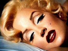Women wore dark red lipstick and very heavy eye makeup that gave them a very dramatic look.