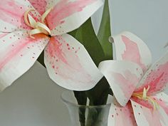 I just love these awesome stargazer-like lilies made from coffee filters, plus this website has some great tutorials for a variety of handcrafted paper goodies!