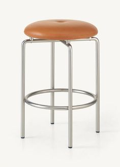 The elegance and simplicity of the Circular Table Series extends to a casual seat.<br /><br />A sturdy but agile floating presence is created by the stool's base, made from circular sections of plated steel tubing. The legs are bent to the tightest possib