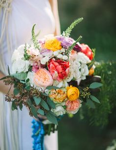 Vibrant, pretty, bright bouquet. Bohemian macrame wedding inspiration. Let's Frolic Together photography. Venue: The Slate Barn & Gardens Vista, California
