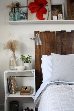 Reclaimed wood headboard and crates as bedside table