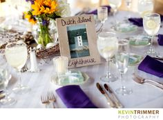 Wedding reception table setting, decor and centerpiece. Sunflowers with beach and ocean theme. Purple and white. www.kevintrimmer.com