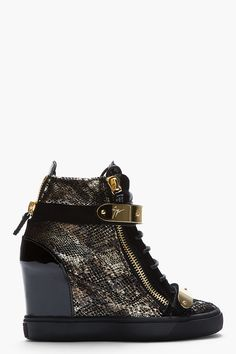 Giuseppe Zanotti Gold Snakeskin Loren Z75 Wedge Sneaker -  Giuseppe Zanotti Gold Snakeskin Loren Z75 Wedge Sneaker Giuseppe Zanotti Leather wedge sneakers in black and gold. Snakeskin pattern printed throughout. Gold_tone hardware. Round toe. Tonal lace_up closure. Signature metal bar details at midrow and toe cap with velcro closure. Embossed suede...