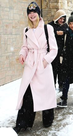 Elle Fanning in a long pink wrap coat and wide leg black pants - click through for more winter outfit ideas