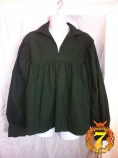 This is a Men's Navy Peasant Shirt. It is a perfect item for a Men's Renaissance Faire outfit. It is made of 100% cotton. It has a open front, collar, and cuffs which can be turned up. It is available in sizes Small through XLarge. It has a fitted chest cut, with a pleated torso on the front and back, to allow for a wide range of motion and movement and gives a billowed effect when belted or tucked in.