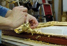 Gold sheets are carefully brushed on piece by piece for an exquisite finish.