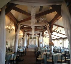 Rustic wedding draping and chandelier.