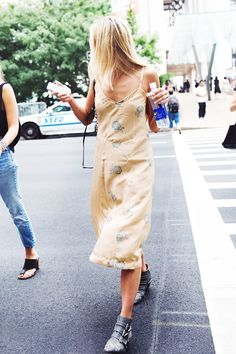 Slip Dress + Ankle Boots 7 Warm-Weather Outfits You Can Always Count On via @WhoWhatWear