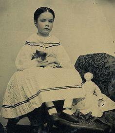 Victorian child with pet cat and doll