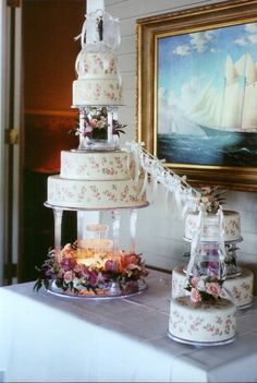 4 tier fondant wedding cake.  Hand painted rose motif.  Satellite cakes connected with staircases & bows.   Fresh flowers around fountain and tops of cakes.  7 tiers total.  This was the second wedding cake I ever made ~ it was for my friends Marc n Marys wedding.