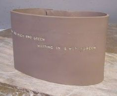 Alphabet pasta pressed into wet clay (for quotes, names, potery, etc.) Burns out during first firing.