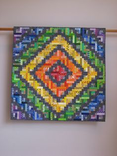 """Amazing """"Radiant Barn Raising"""" quilt by Tina Curran.  I love the way the black fabric makes everything pop!"""