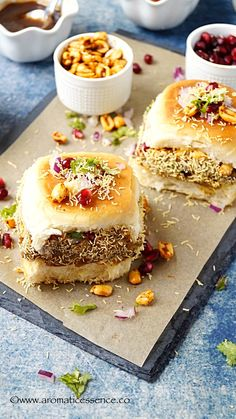 Dabeli is a popular street food that originated in Kutch, Gujarat in India. Hence it is also known as kutchi or kachchi dabeli! It is a common and popular street food in Mumbai too. It is easy to spot tiny Mumbai Street Food, Indian Street Food, Food Trucks, Vegetarian Breakfast Recipes, Snack Recipes, Sandwich Recipes, Vegetable Recipes, Comida India, Chaat Recipe