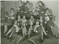 World's Fair usherettes (1939) each one with what looks to be a Coty Airspun powder compact.