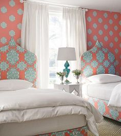 "Headboard upholstery: ""Jakarta"" print in Coral/Turquoise; Wallpaper: ""Ivana"" in Coral/Turquoise @Thibaut Wallpaper Fabrics Furniture"