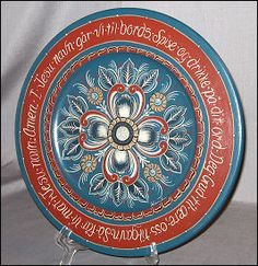 This is a Norwegian prayer plate done i Rogalund style. It reads: In Jesus' name to the table we go To eat and drink according to His word. To God the honor, us the gain, So we have food in Jesus' name. (Designed by Jean Honl).