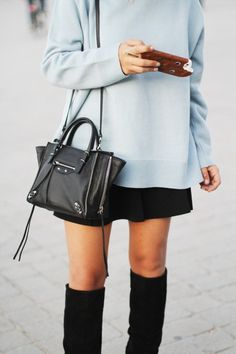 Baby blue sweatshirt and black skirt