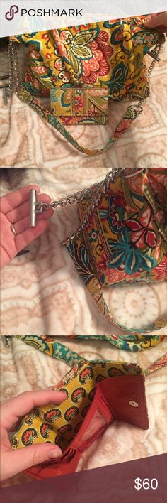 Vera Bradley purse/wallet Matching purse and wallet! The purse has the two small handles and also a larger handle that can be removed easily. The purse is a very soft fabric, not stiff or stands up on its own Vera Bradley Bags Shoulder Bags