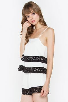 """This top has the prettiest embroidery cut out details! We love the black trim with the white piece. Pair with our Beth Embroidery Shorts for an effortless look.  - Tiered cami top with embroidery cut out detail - Square neck - Adjustable strap - Color: White  Size + Fit - Model is wearing size S - Measurements taken from size S - Chest: 34.5""""   Additional Information  Fabric100% Polyester PrepackNo CareHand Wash Only"""