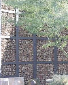 These ECO-MESH® panels were filled with rocks to create a rock wall partition. It's one of the more creative materials used to fill ECO-MESH® by McNichols - Retaining Wall Landscape Walls, Landscape Architecture, Landscape Design, Garden Design, Gabion Fence, Gabion Wall, Garden Fencing, Garden Landscaping, Dream Garden