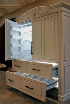 Designer fridge!!!! Kitchen cabinets hide appliances